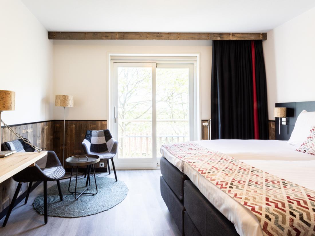 Strandhotel Westduin Hotelovernachting Hotelkamer Zitje