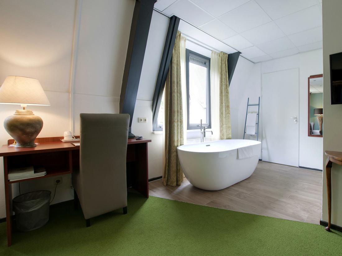 Hotelarrangement Gelderland Hotelkamer Deluxe Kamer Bad